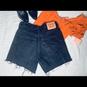 Vintage black 550 denim Levi shorts.